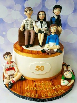 Novelty birthday cakes example with custom family figurine toppers